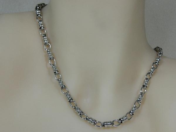 Zilveren fantasie mode schakel halsketting met grote karabijn sluiting