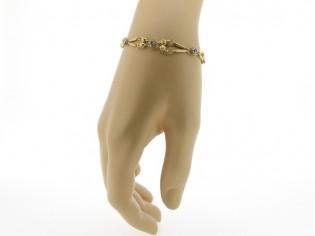 Gouden armbandje met romantische schakeltjes en ingelegde  zirkonium steentjes