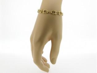 Gouden armbandje met elegante schakeltjes en kleine balletjes