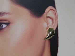Gouden oorstekertjes half ovaal