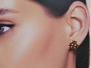 Gouden kinder oorknopje lieveheerbeestje