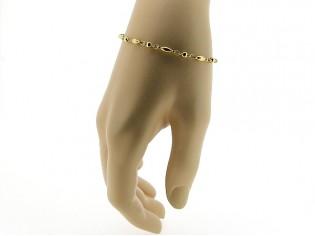 Gouden armbandje met fantasie balletjes schakel