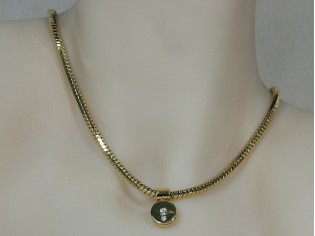 Gouden ketting met hangertje facet geslepen slangen ketting