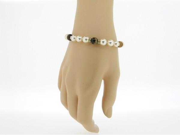 Gouden parel armbandje handgeknoopt met Tijgeroog edelstenen