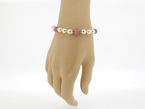 Zilveren parel armbandje handgeknoopt met Rhodochrosiet edelstenen