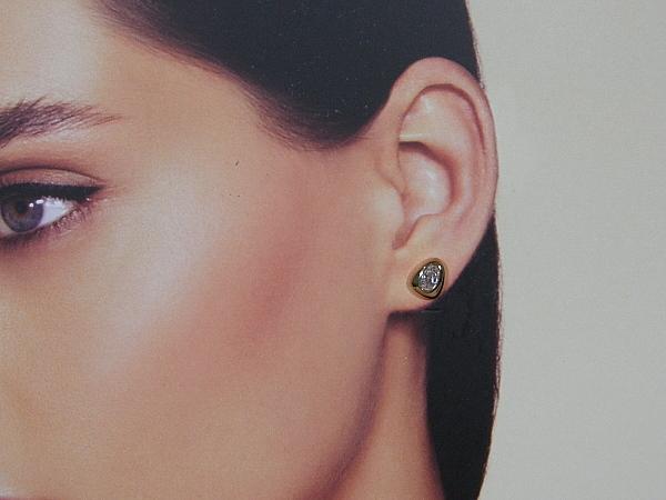 Rosé gouden oorknop met heldere zirconia steentjes