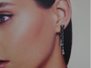 Lange oorhanger met cobra kettinkje