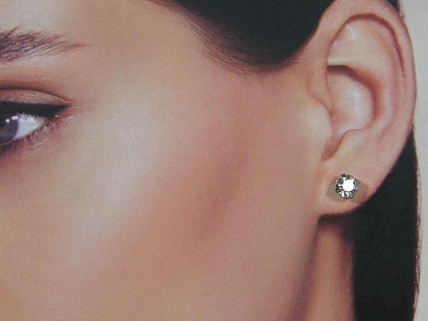 Zilveren mini strass oorknopje