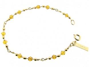 Gouden armbandje met Swarovski topaas kristallen