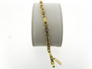 Gouden armband met modieuze hoogglanzende schakel en zirkonia steentjes met vlindersluiting