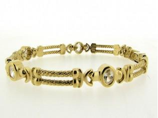 Gouden armband met modieuze kabelschakel en zirkonia steentjes met vlindersluiting