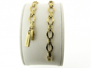 Gouden armbandje met fantasie schakeltjes en vlindersluiting