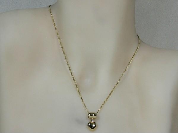 Gouden ketting met hangertje hartje voorzien van zirconia steentje