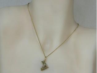 Gouden ketting met hangertje kunstschaats