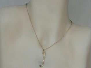 Gouden ketting met hangertje golfstick